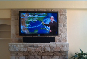 samsung-living-room-tv-installed-on-stone-with-sound-bar-irving-tx